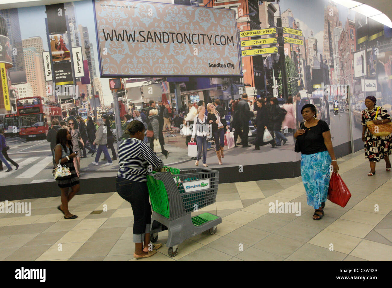 Saturday shoppers inside Sandton city shopping mall. Johannesburg. South Africa. - Stock Image