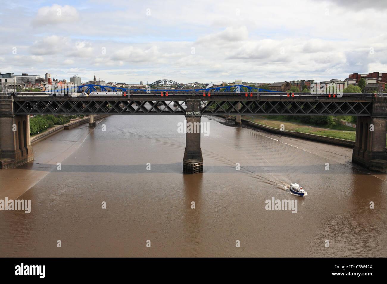 Two East Coast high speed trains pass on the King Edward Bridge between Gateshead and Newcastle, NE England, UK - Stock Image