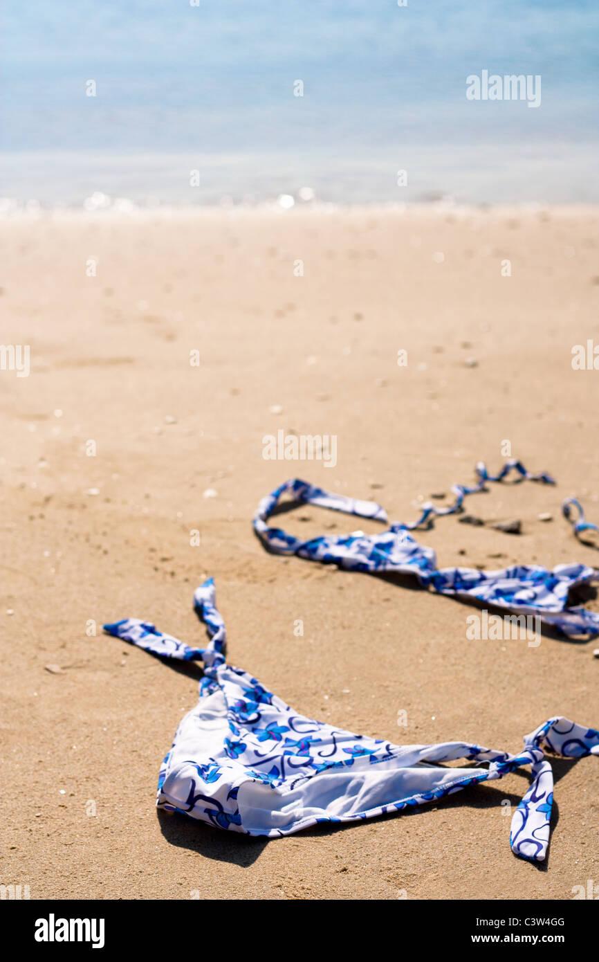 Blue Bikini on a Sand Beach - Stock Image