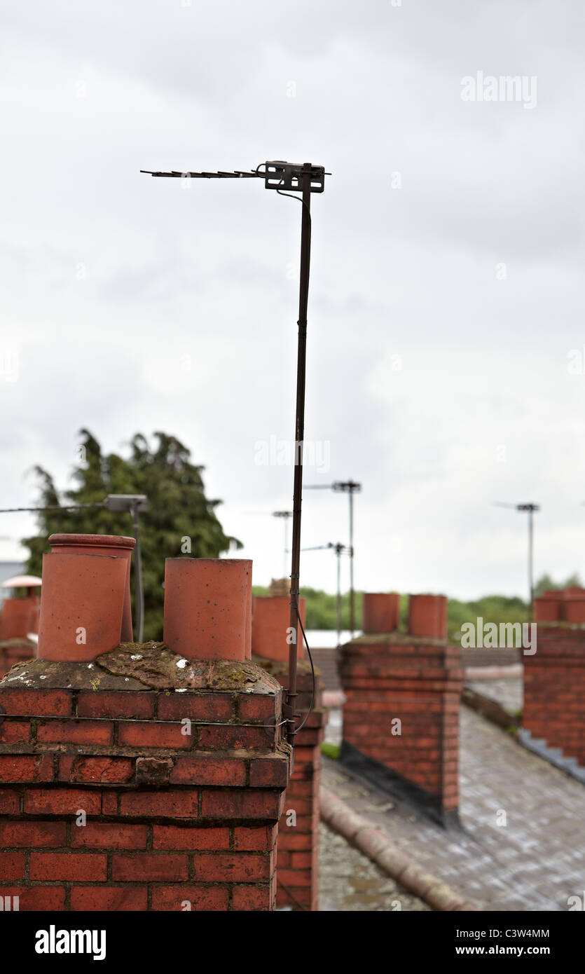 An analogue television aerial on the roof of a residential house. Most UK homes will soon only be able to receive - Stock Image