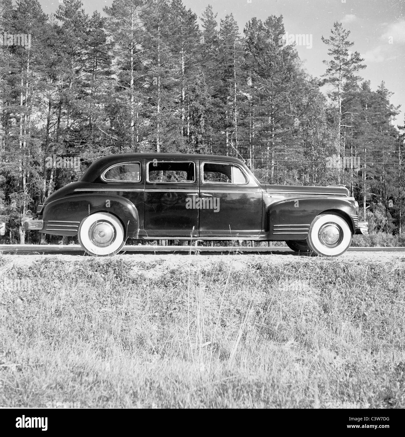 1950s. An historical picture by J Allan Cash of a ZIS car parked on a forest road in Georgia. - Stock Image