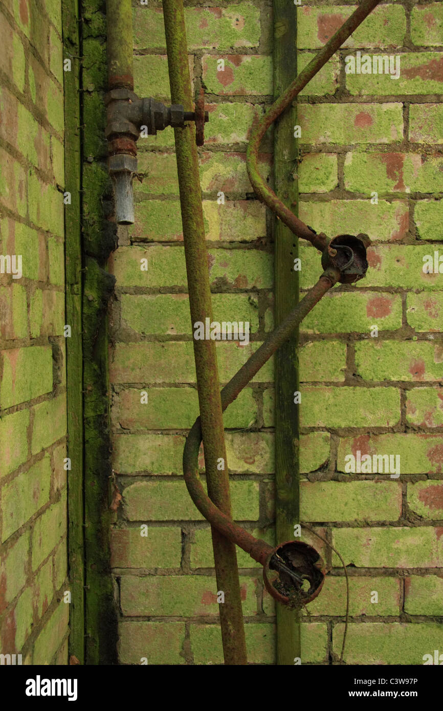 Rusty pipes found in derelict building. Stock Photo