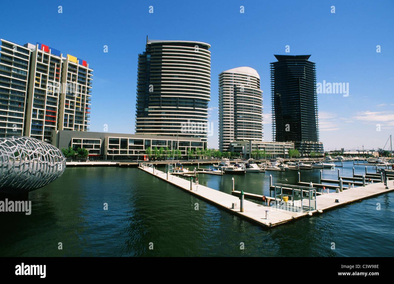 Yarra's Edge withWebb Bridge (l.) in the docklands of Melbourne, Victoria, Australia - Stock Image