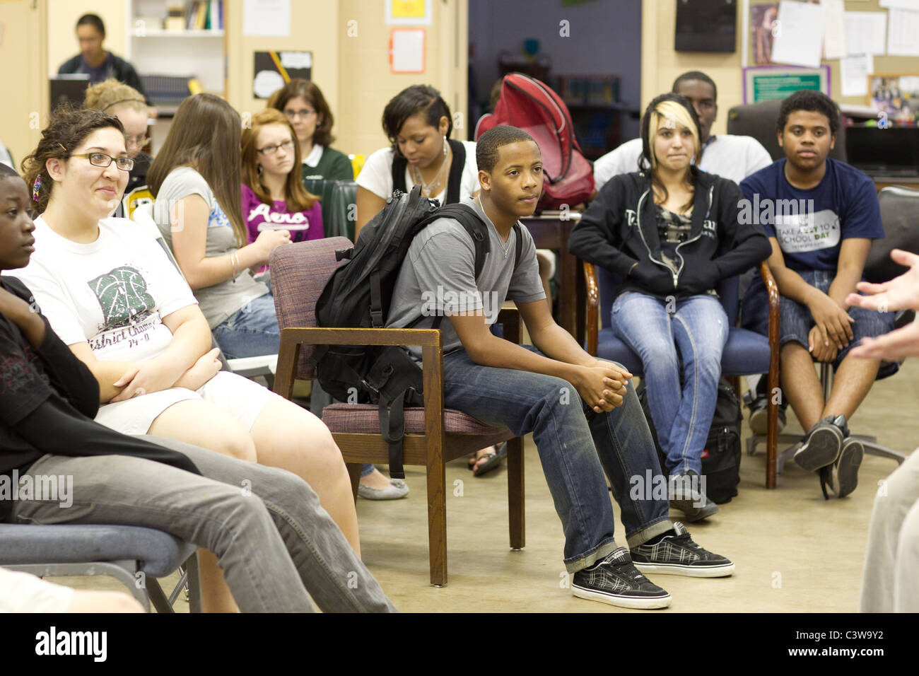 Ethnic and racial mix of students at Rapoport Academy public charter high school in Waco Texas listen to teacher - Stock Image