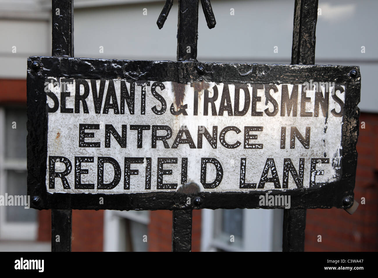 Servants and tradesmen entrance sign, mansion block, Cromwell Road, London - Stock Image