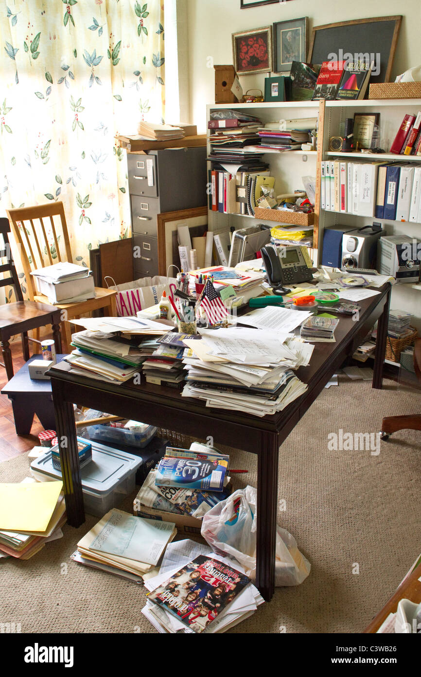 Sacks of papers clutter teacher's desk in her classroom at Rapoport Academy public high school in Waco Texas - Stock Image