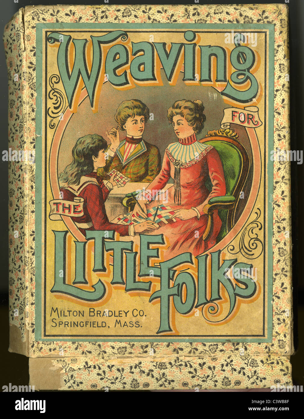 Circa 1860s Weaving for the Little Folks box top, by Milton Bradley. - Stock Image