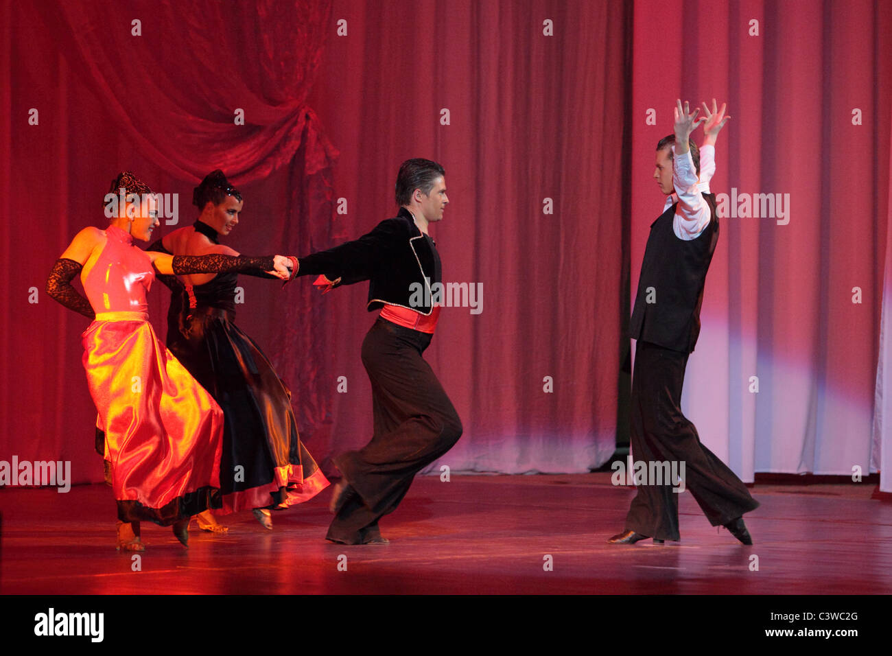 Two girls and two boys dancing flamenco - Stock Image