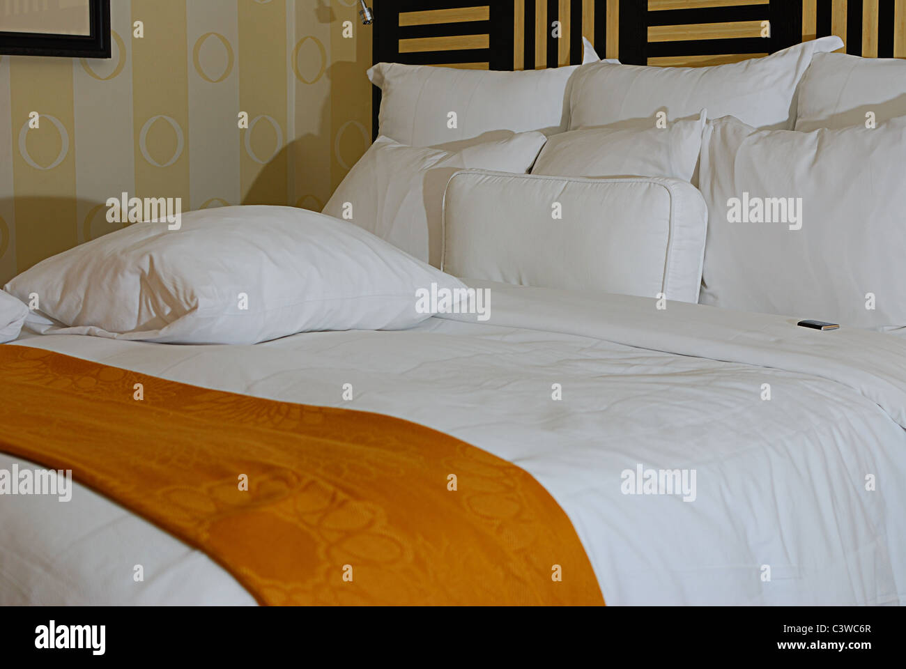 Modern Hotel Room with candy on the pillow Stock Photo