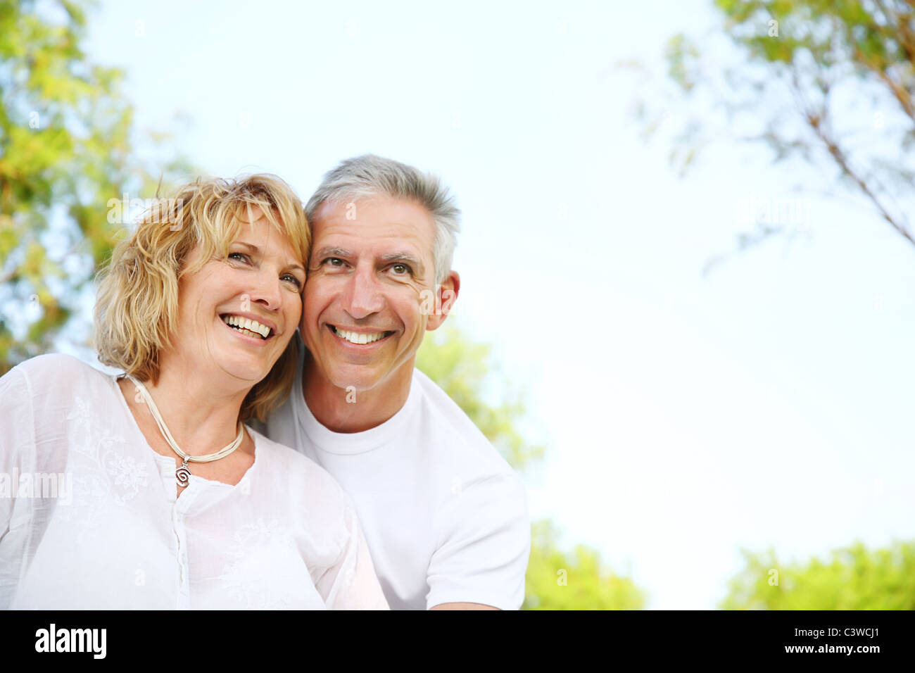 Close-up portrait of a mature couple smiling and embracing. Stock Photo