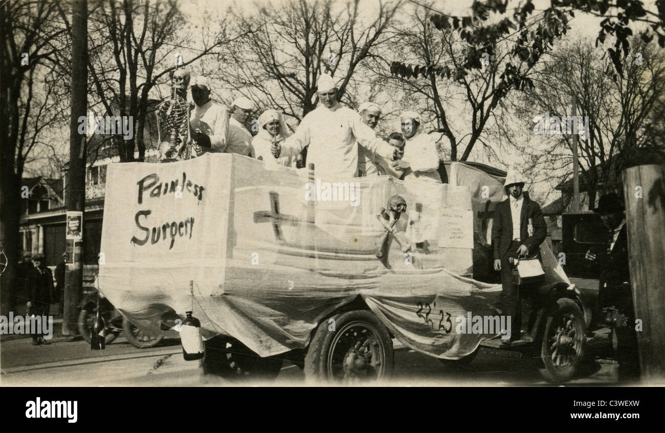 Circa 1920 Medical School students stage a mock 'Painless Surgery' hospital truck, possibly in a parade. - Stock Image