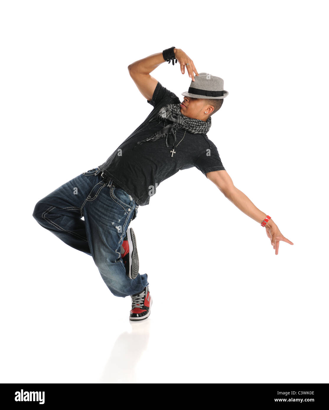 Hip hop dancer performing isolated over white background - Stock Image