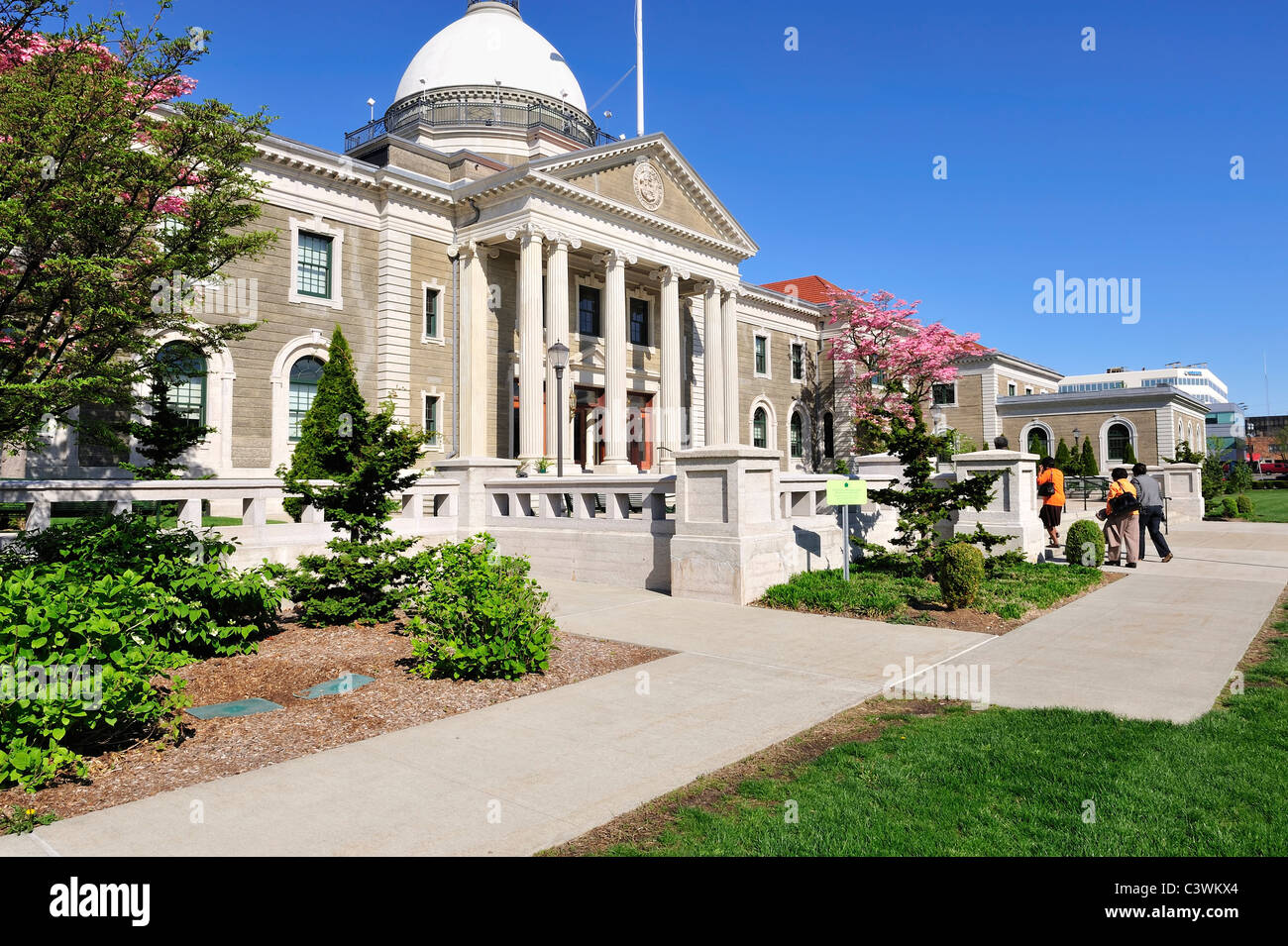 Nassau County Executive and Legislative Building front exterior seen facing NW, far people on walkway, May 9, 2011, - Stock Image