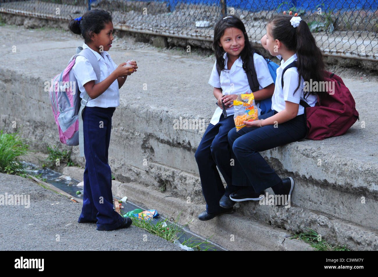 Schoolchildren in the impoverished district of La Carpio, San José Costa Rica-In Costa Rica primary education - Stock Image
