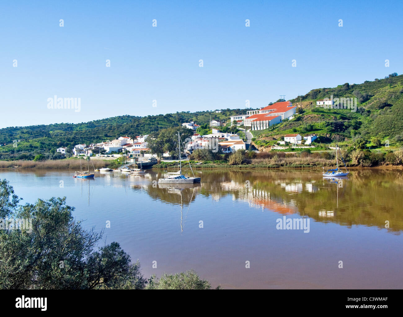 Yachts at anchor at Guerreiros de Rio on the river Guadiana Algarve, Portugal - Stock Image