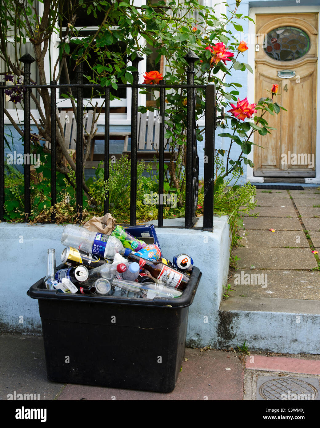 Recycling bin outside a worn front door and untidy garden in Brighton . Picture by Julie Edwards Stock Photo