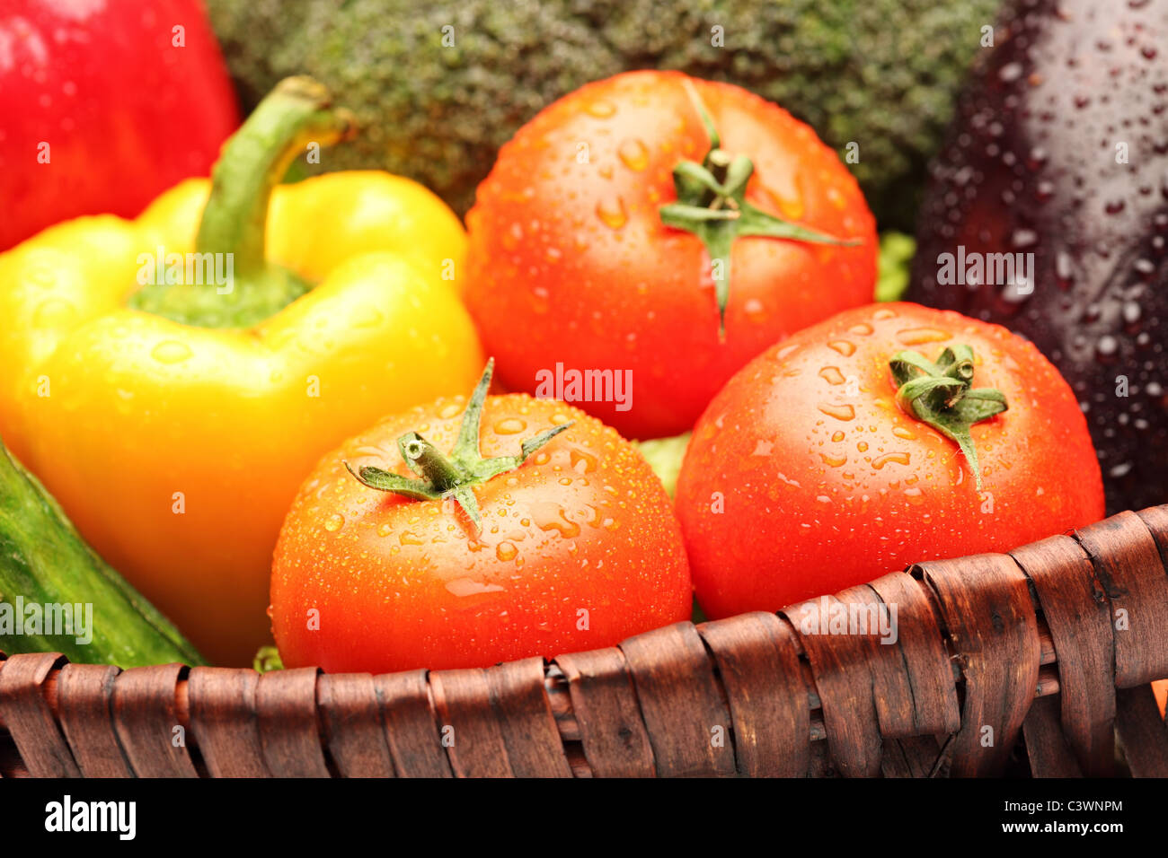Close up of various vegetables in basket - Stock Image