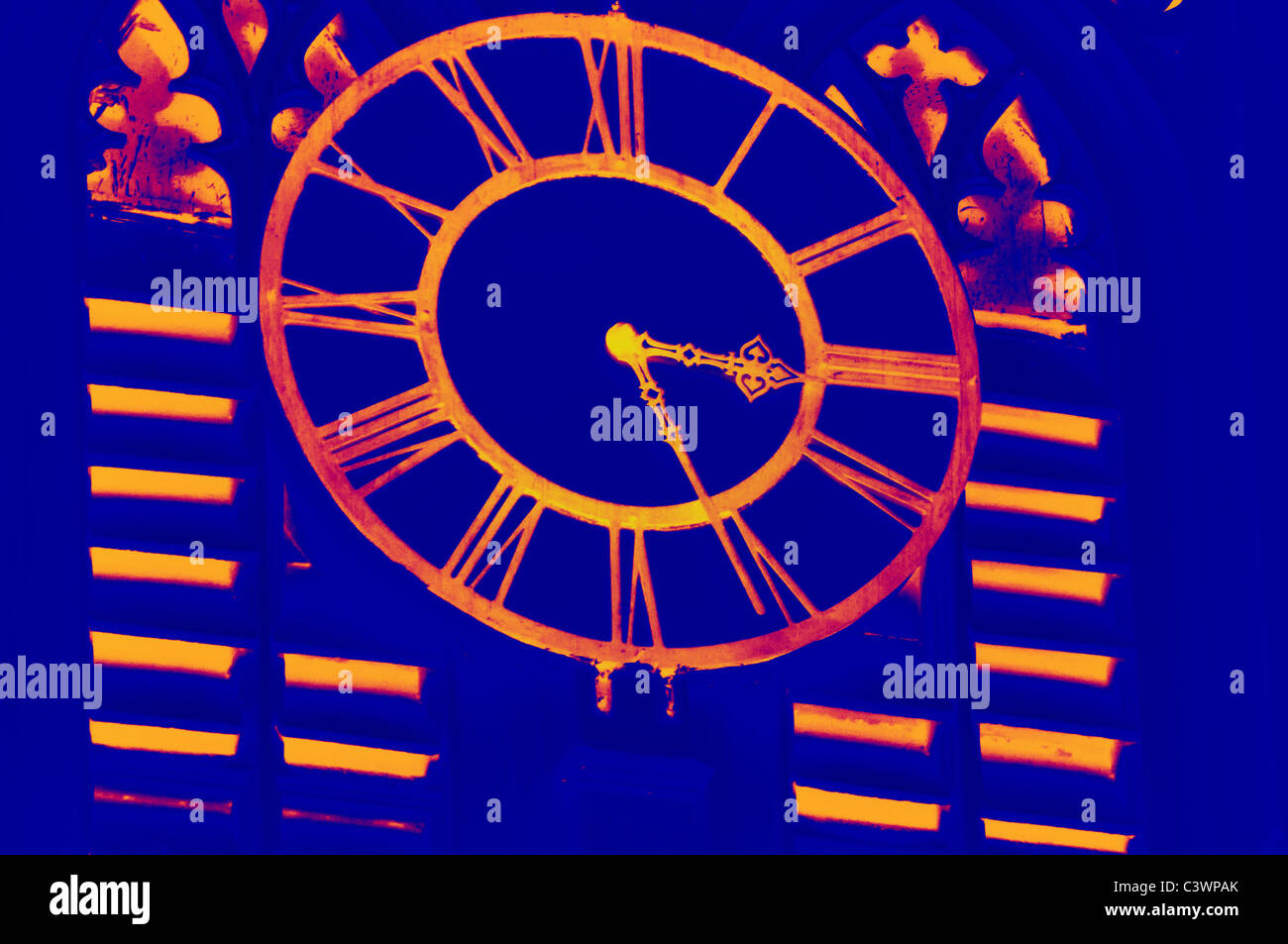 A old clock on the wall of the tower of St. Paul's Cathedral, Calcutta, Kolkata in Infra red (IR) - Stock Image