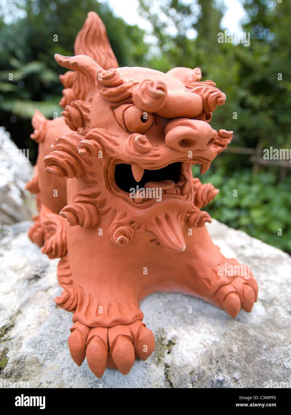 Shisa ( shishi, shisaa ) dog / lion. Traditional Okinawan talisman at Ryukyu Mura, Okinawa, Japan - Stock Image