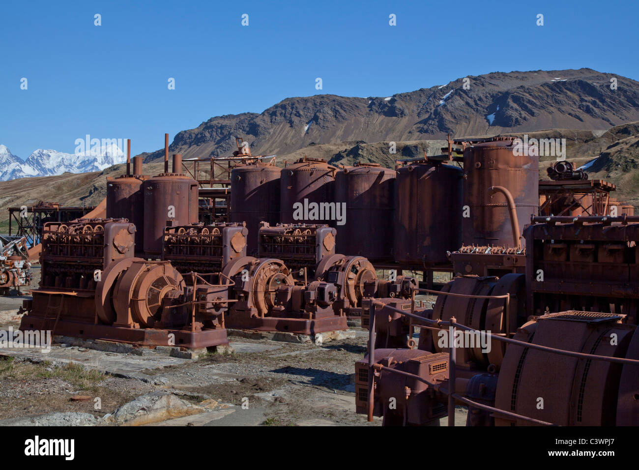 The rusting red machinery at Grytviken whaling station, South Georgia Island Stock Photo