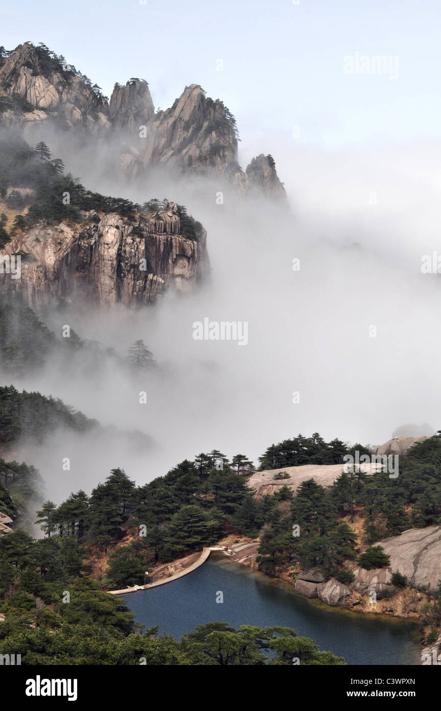 Landscape of mountains in the morning fogs - Stock Image