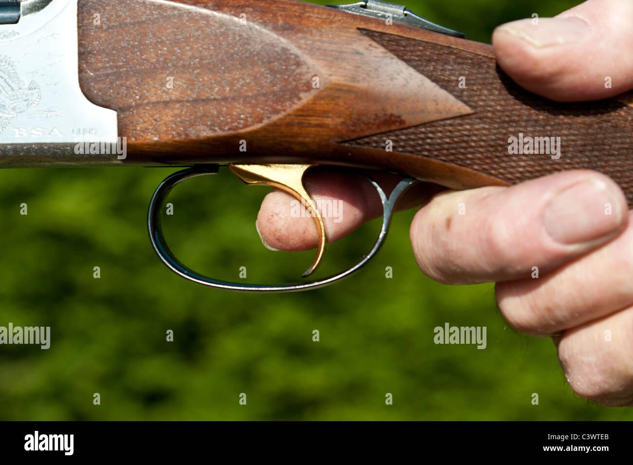 close up of mans finger on the trigger of a double barrel shotgun.landscape format.copy space. - Stock Image