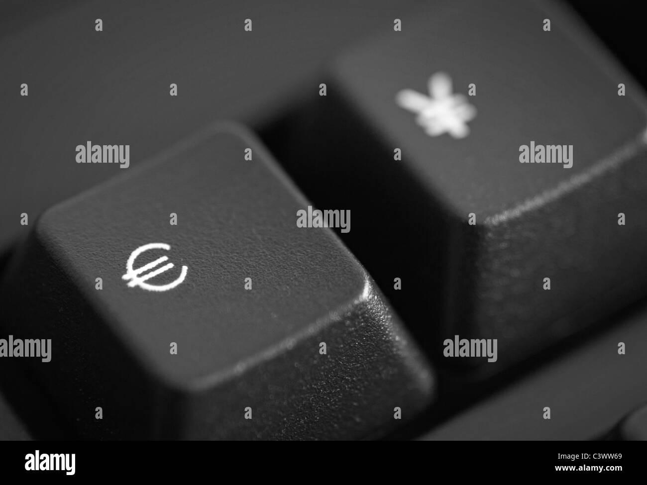 close up of a Euro Symbol and Yen Symbol keys - Stock Image