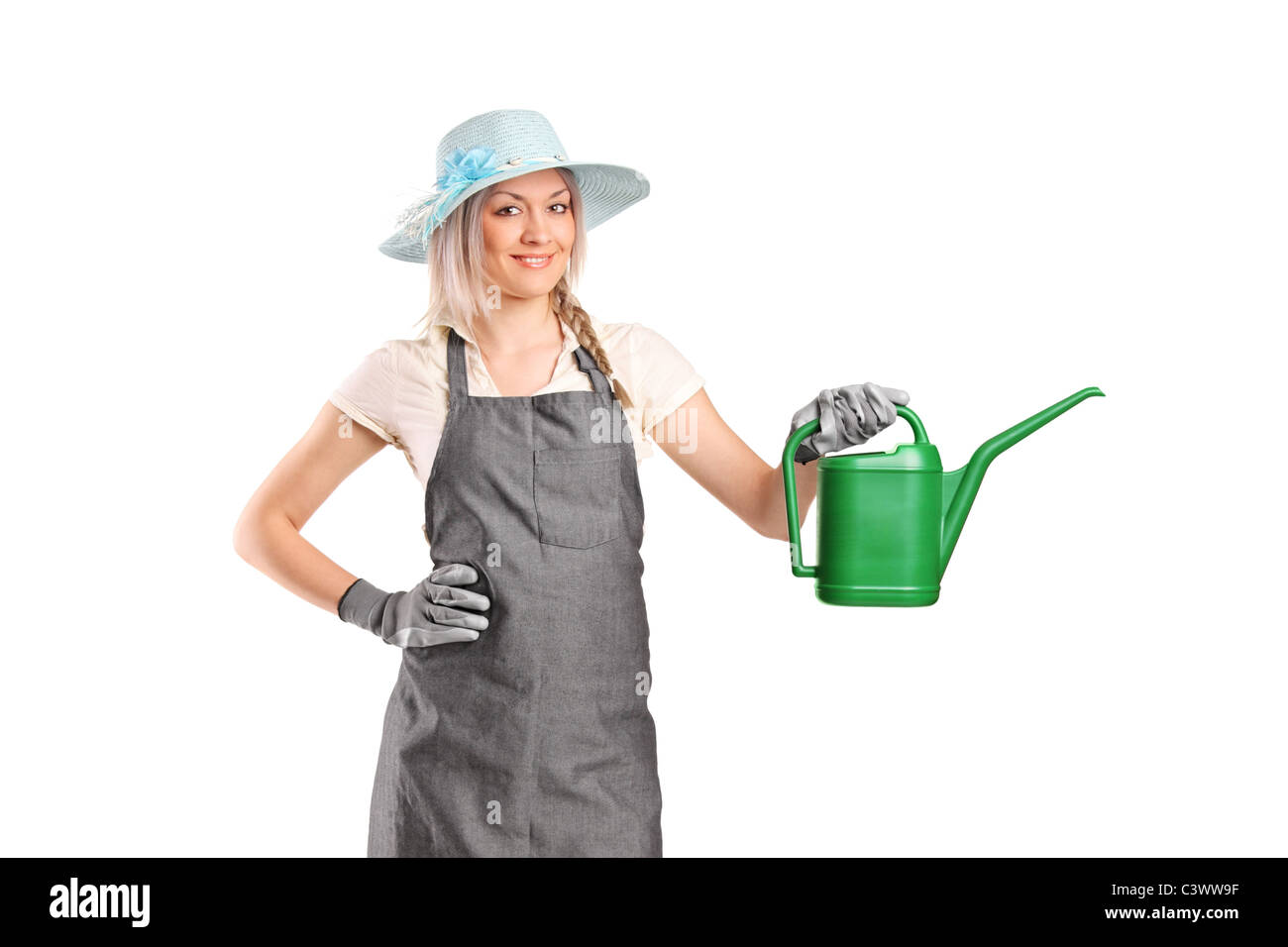 A beautiful female gardener with watering can Stock Photo