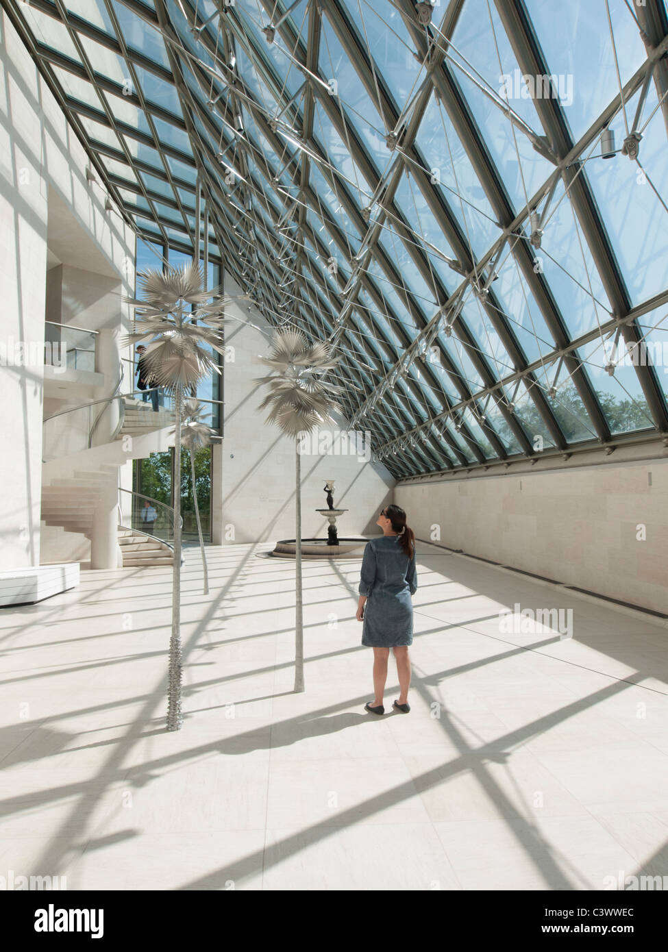 Woman in Sculpture Hall at Modern Art Museum MUDAM or Musee d'Art Moderne Grand Duc Jean; Luxembourg City - Stock Image