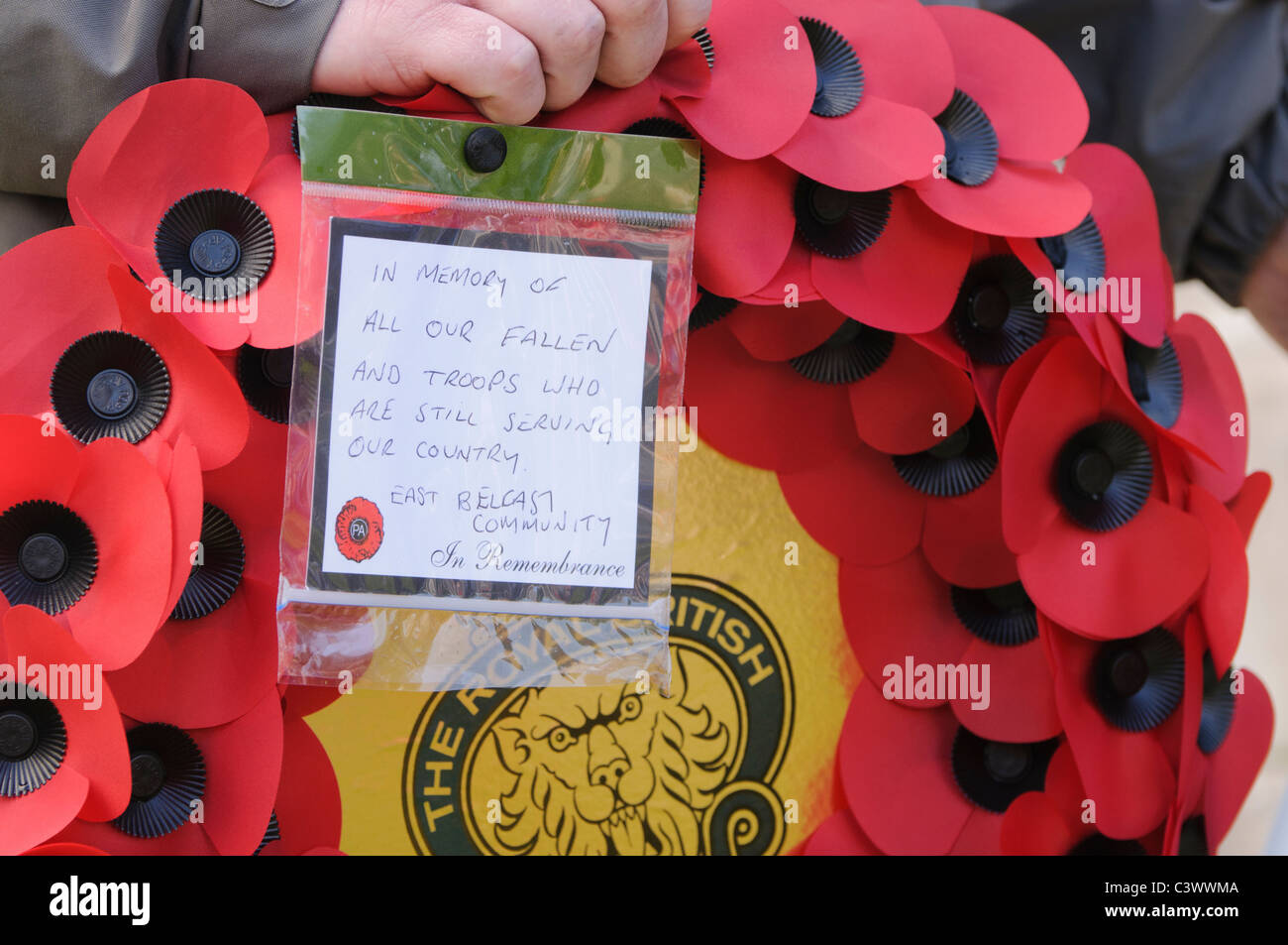 Poppy wreath from people of East Belfast, dedicated to British soldiers - Stock Image