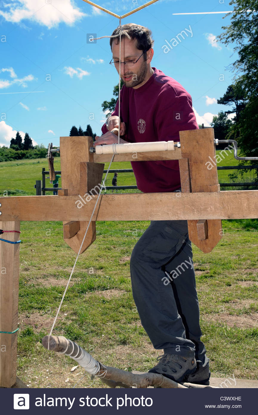 Man working a foot operated pole lathe at Aylestone Park, Hereford, UK. - Stock Image