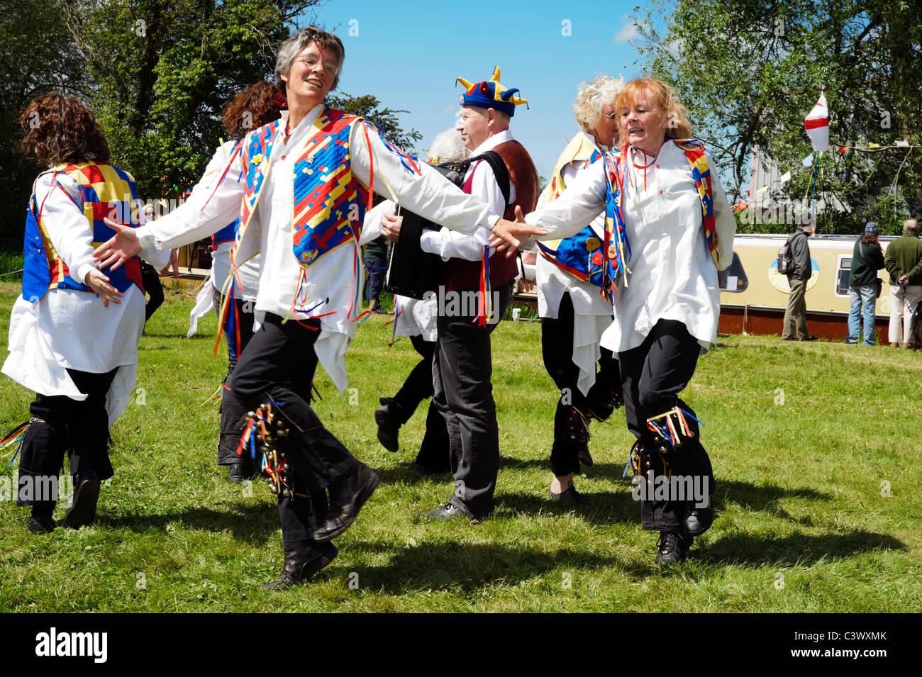 Women morris dancing, Aylestone Park, Hereford, UK. Female morris dancers giving a public performance. - Stock Image