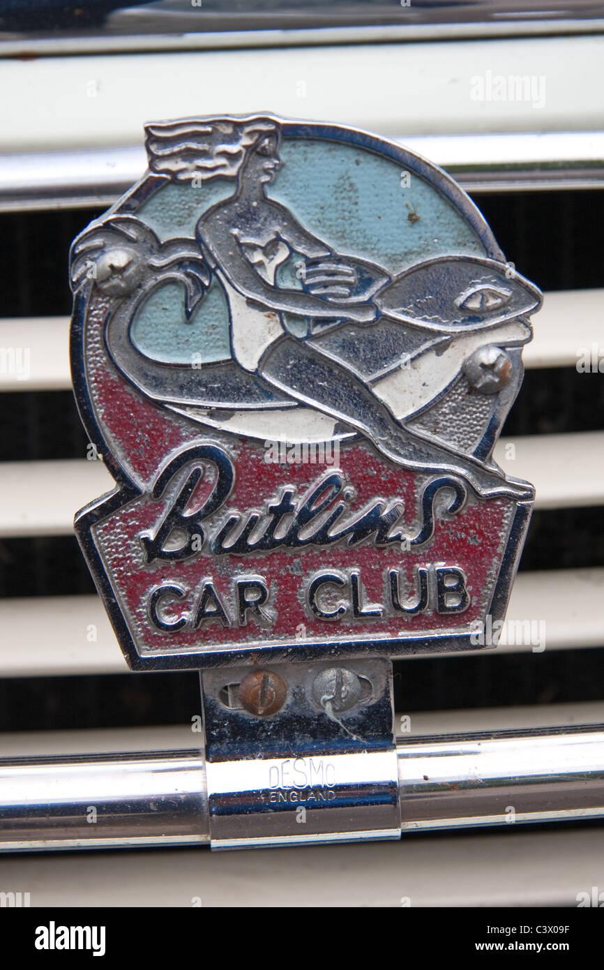 Old Butlins Car Club car badge on classic Morris Minor - Stock Image
