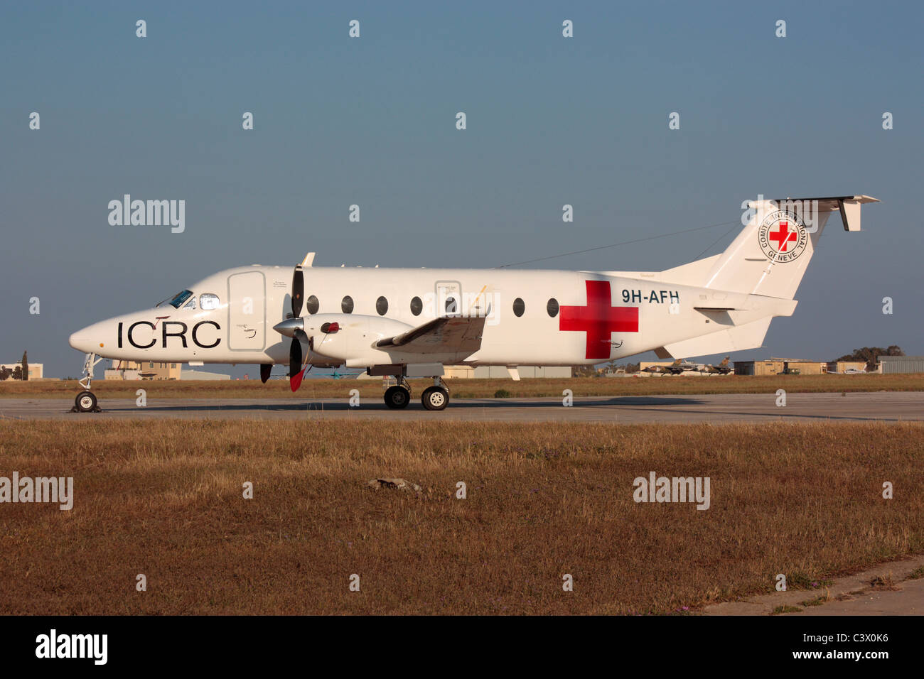 Beech 1900D in Red Cross colours in Malta in connection with the Libyan conflict, 8 May 2011 - Stock Image