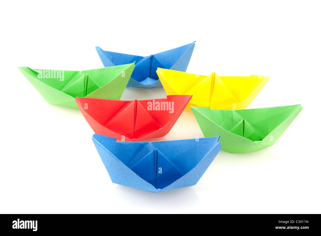 Many Colorful Folded Paper Boats On White Background Stock Photo