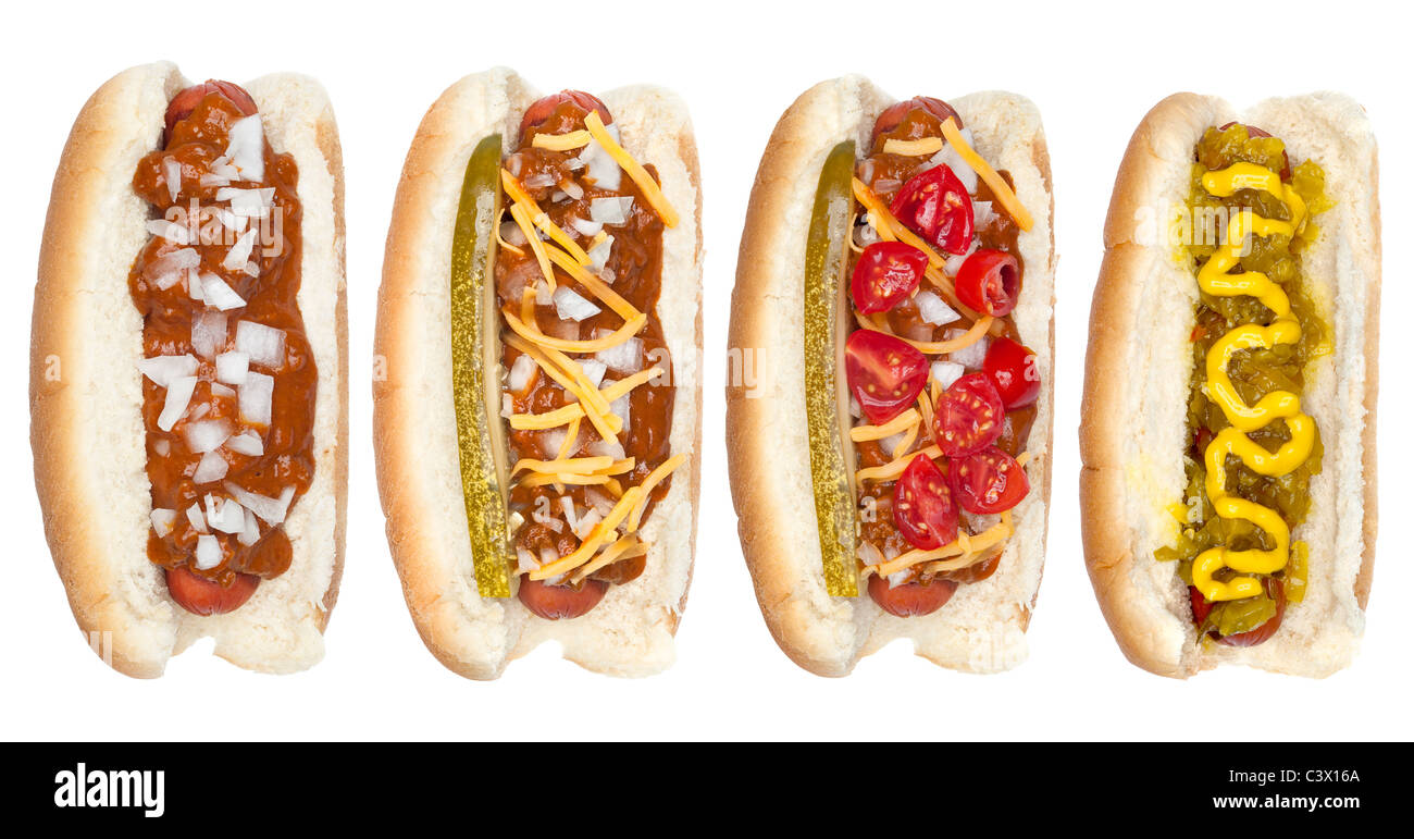 A collection of hotdogs with mustard, ketchup, relish, chili, relish and onions. - Stock Image