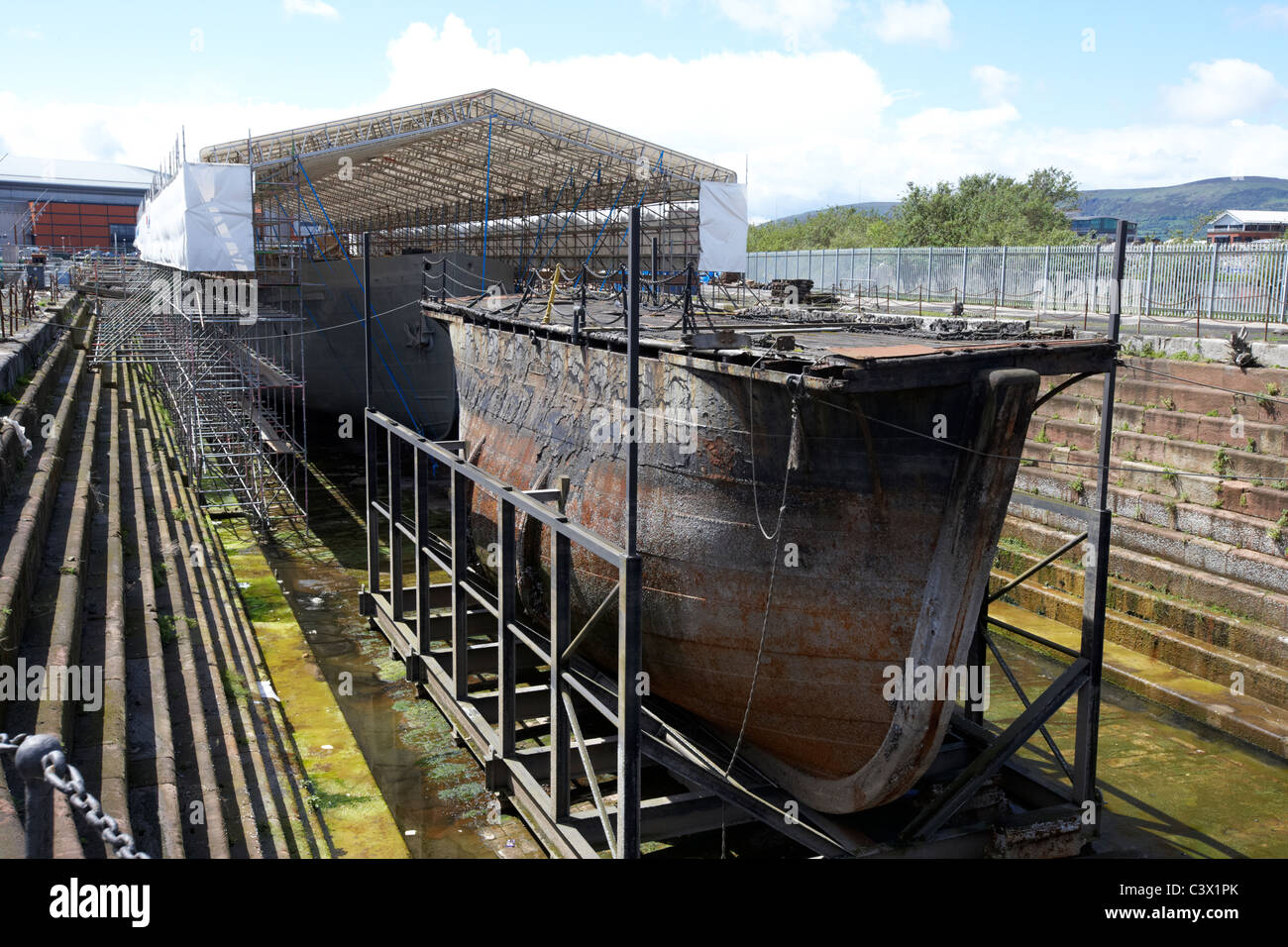 restoration of ss nomadic tender to the olympic and titanic in hamilton graving dock with the original caisson gate - Stock Image