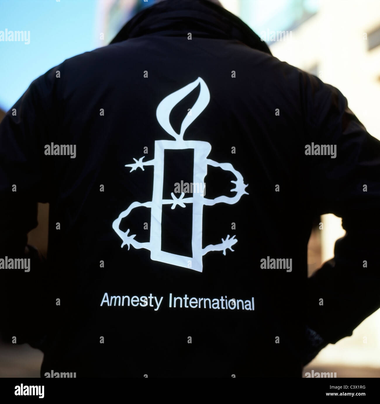 Amnesty International Logo On The Back Of A Charity Workers Jacket