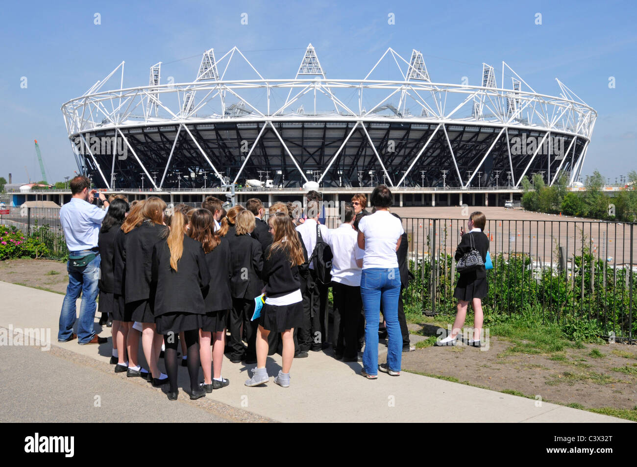 School Trip to the London Olympic park pupils listening to local guide - Stock Image