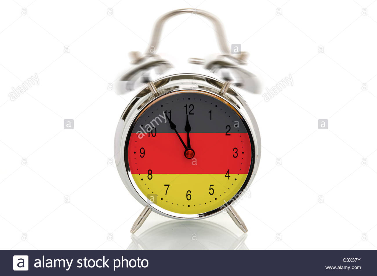 ringing alarm clock with the german national flag time set at five minutes to twelve symbolic image for crisis in germany