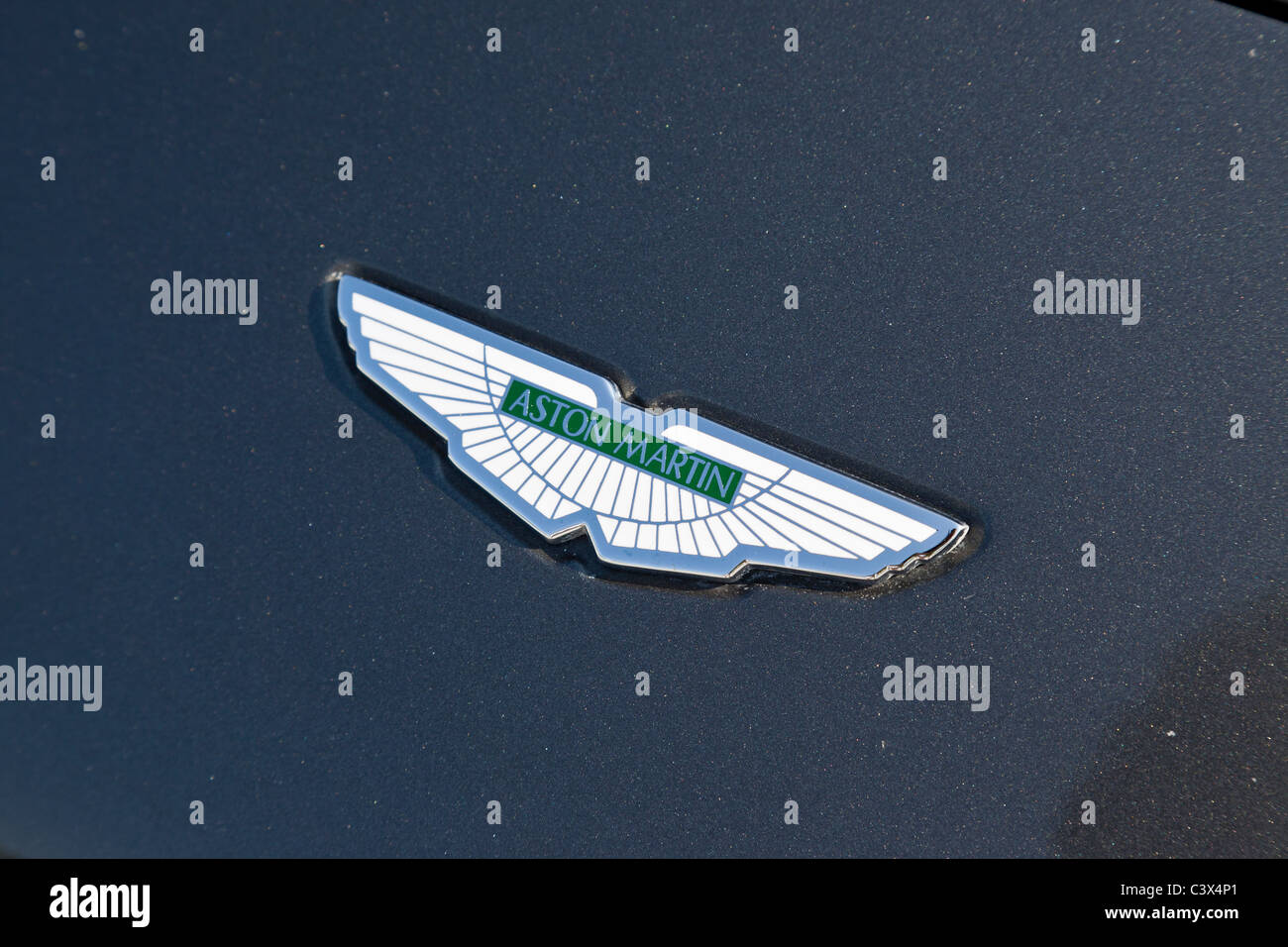 Aston Martin badge on bonnet of car Stock Photo