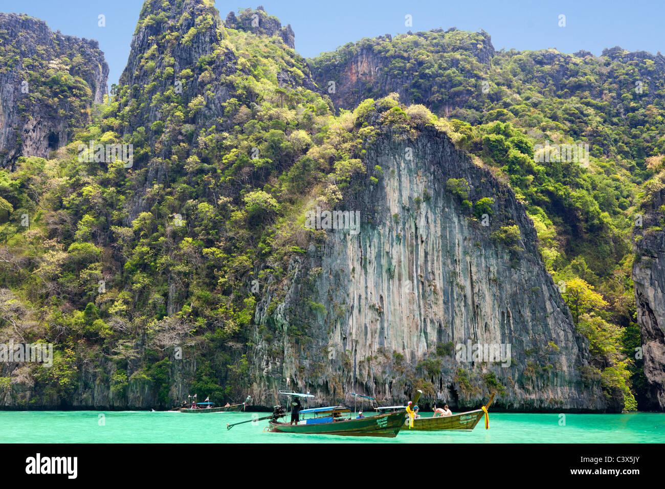 Tourist boats cruising Phang Nga Bay, Phuket Thailand - Stock Image