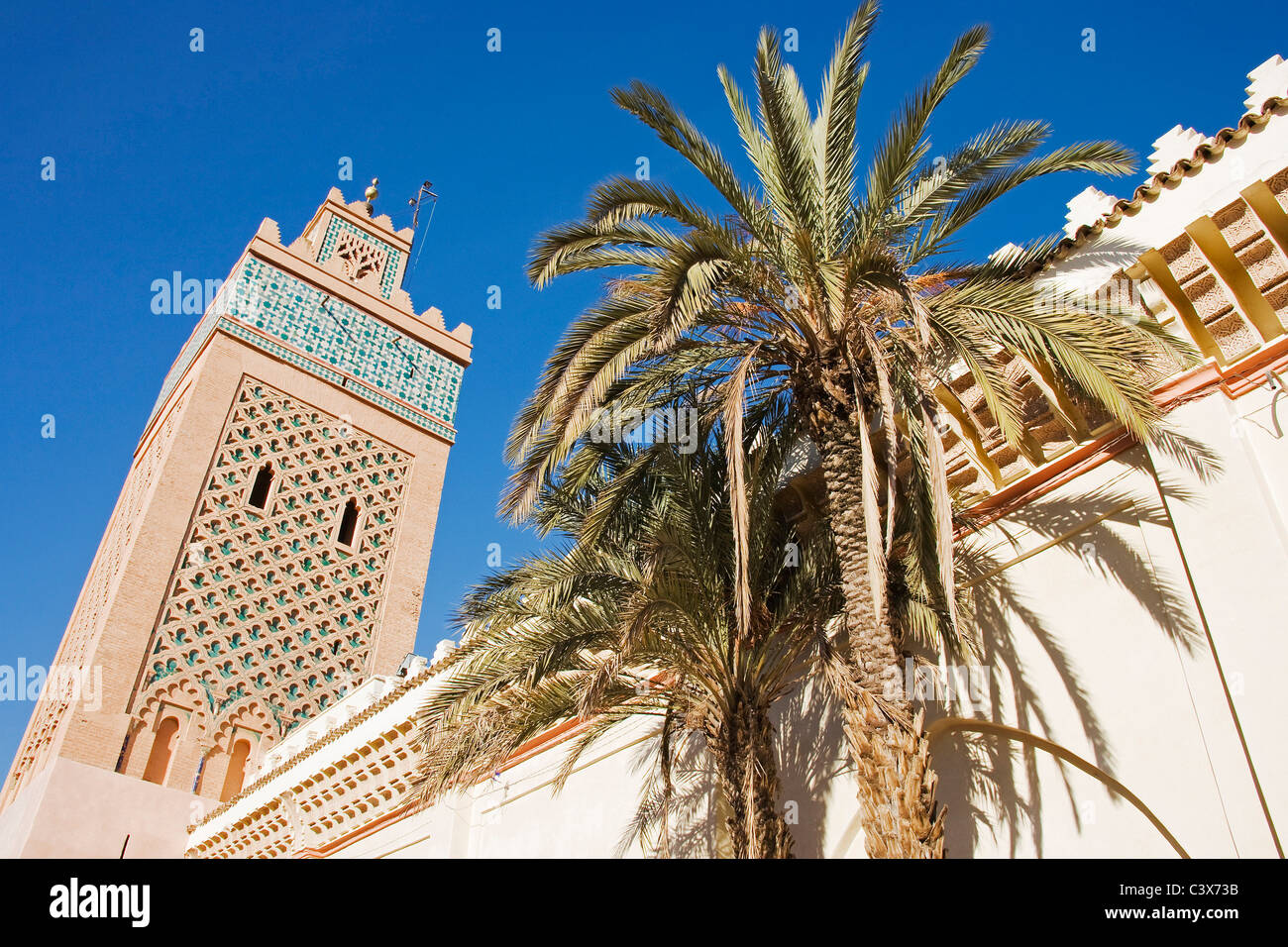 The minaret of the Kasbah Mosque in the Medina (the original Arab part of a town) of Marrakesh, Morrocco. - Stock Image