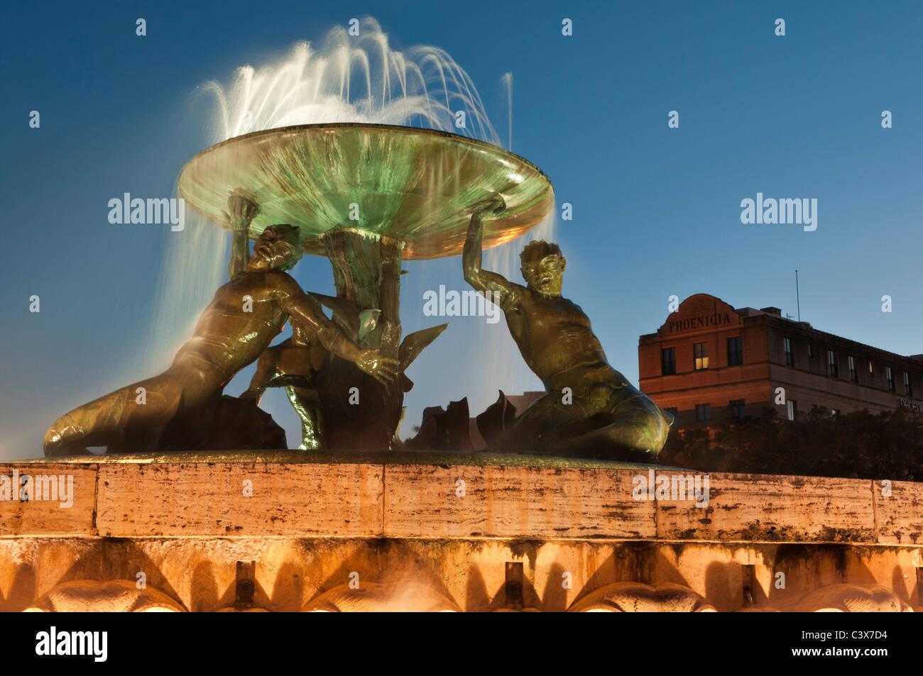 Triton Fountain and Phoenicia Hotel City Gate Square Valletta Malta - Stock Image