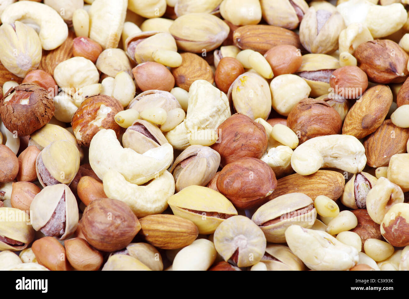 mixed nuts on a background - Stock Image