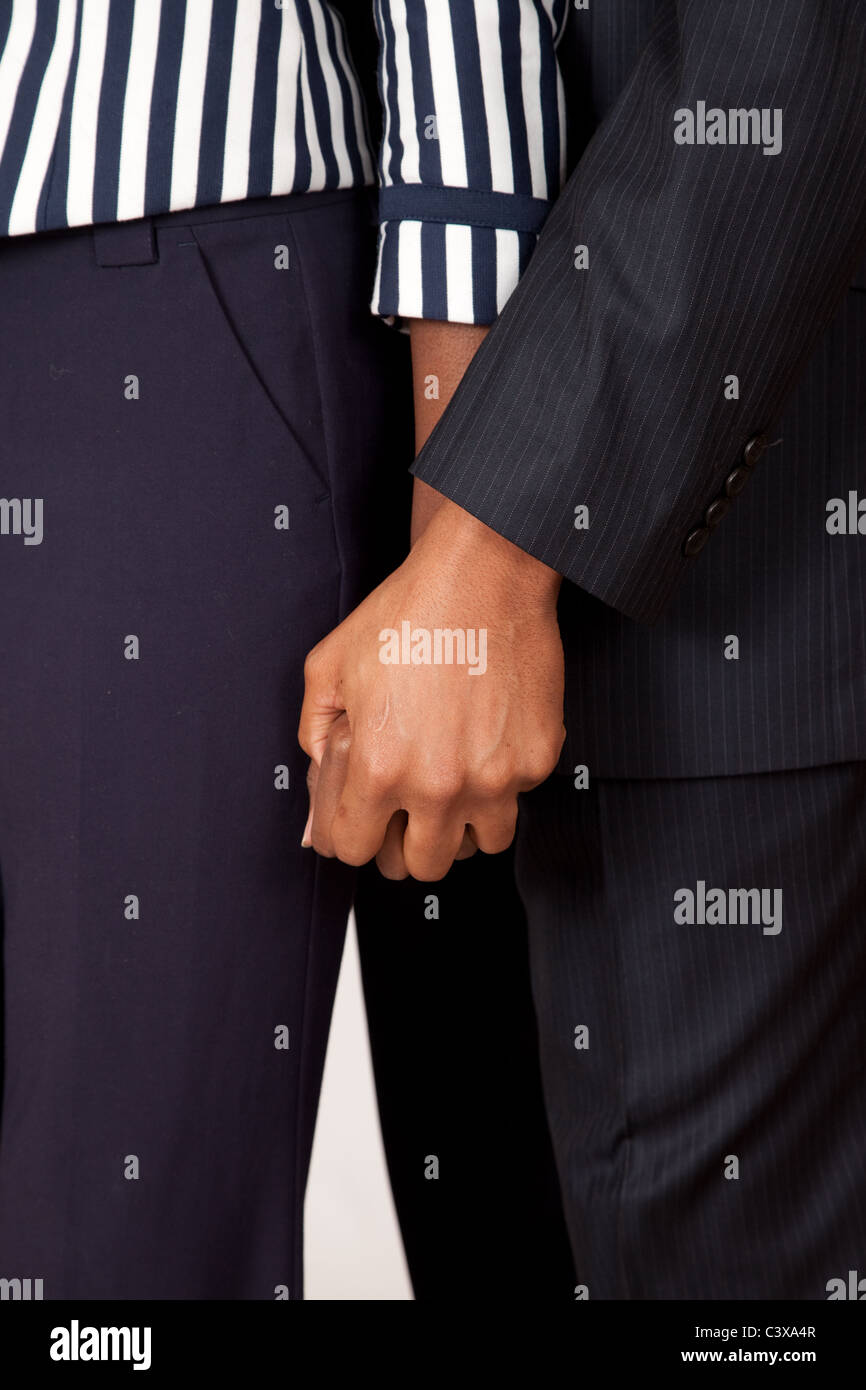Cute romantic black couple standing together and holding hands ...