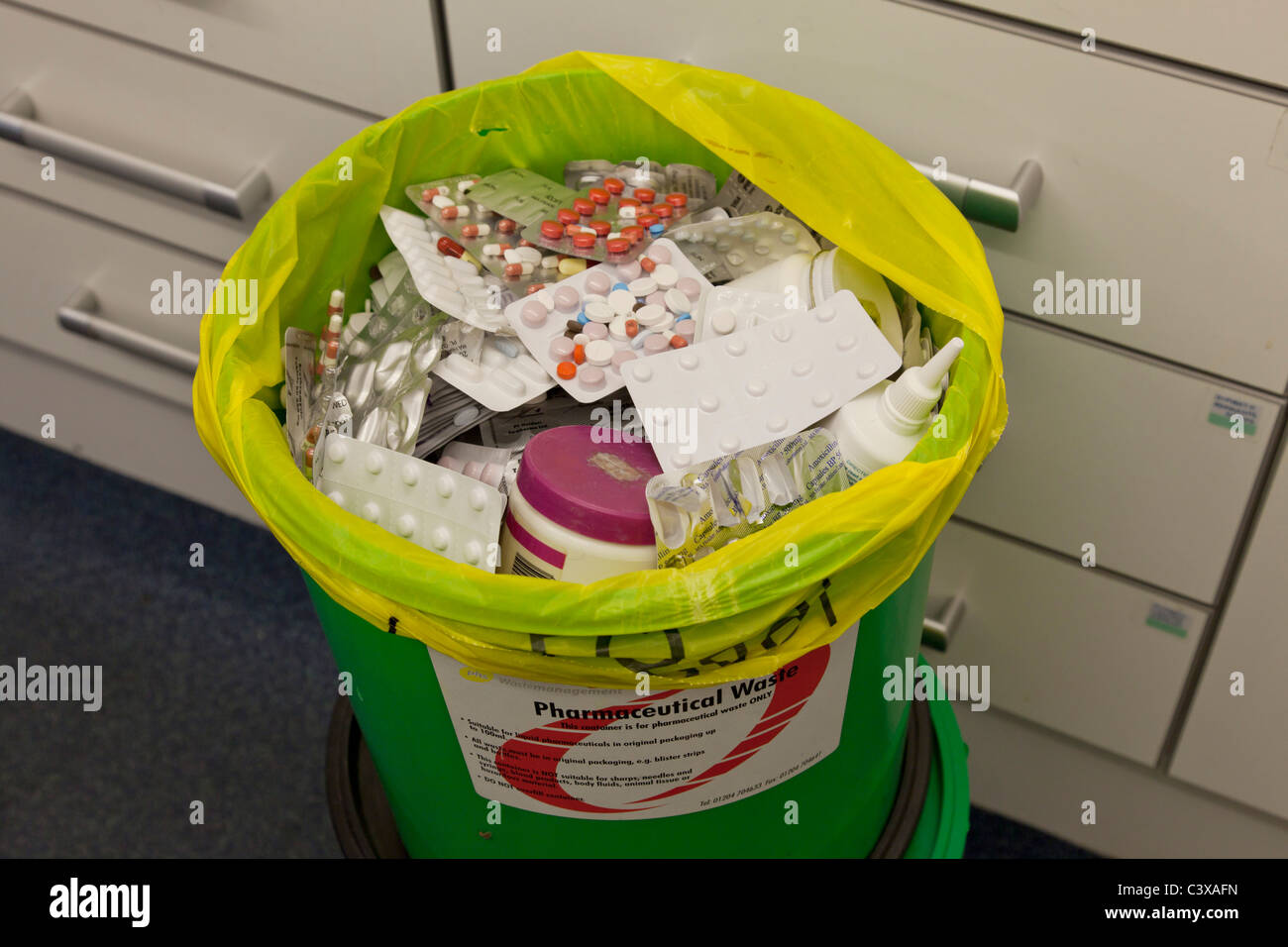 Pharmaceutical drugs for disposal in special DOOP bins after being returned from patients as unwanted or not needed - Stock Image