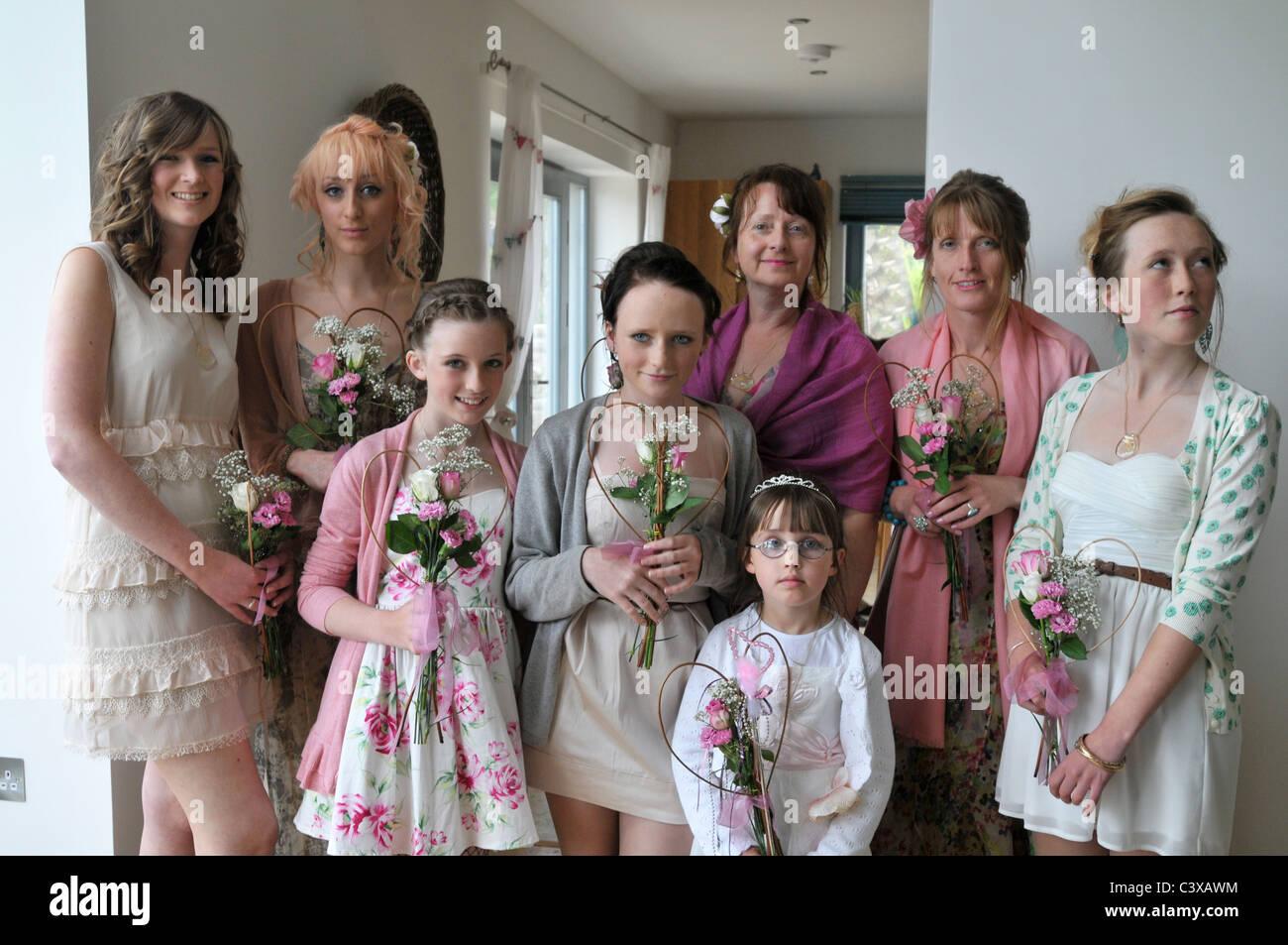 Three generations of bridesmaids, portrait. - Stock Image