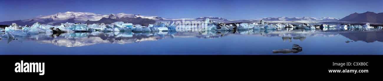 Iceland, Jokulsarlon. Icebergs floating in the lake Jokulsarlon. Panoramic, merged view. - Stock Image