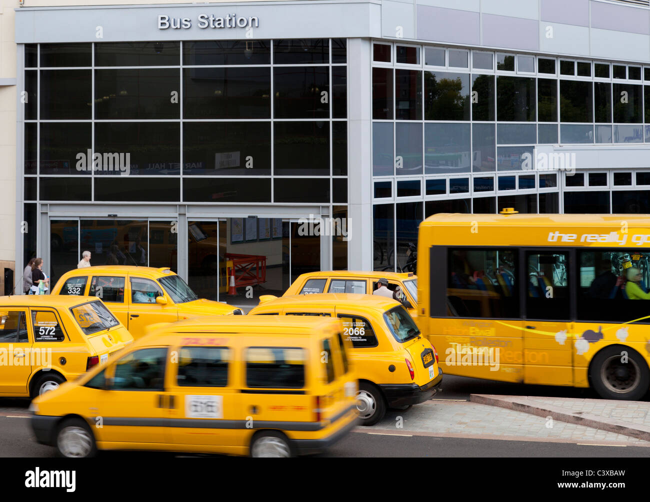 derby bus station with yellow taxi cabs and buses on a busy day city centre derby derbyshire england uk gb eu europe - Stock Image